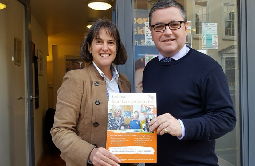 Robert Buckland MP pictured with Amelia Shaw from Beanstalk