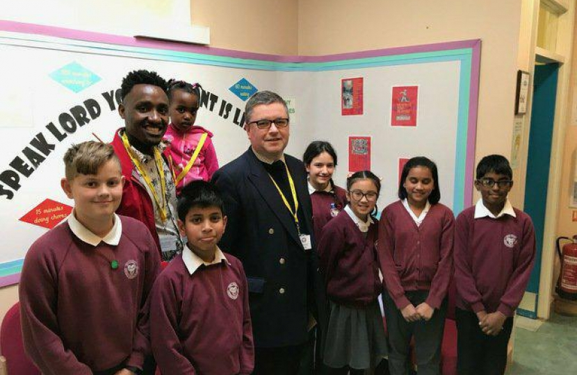 Robert Buckland MP pictured with children from Holy Family Primary School in Swindon